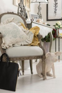 French antique armchairs and sofas, bespoke linen cushions, lsoft leather weekend bags and computer case